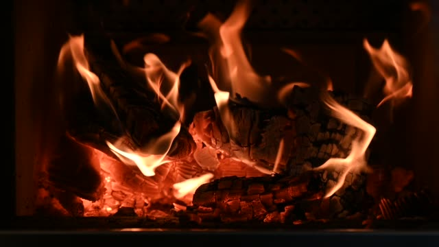 warm flickering flames of wood fire in stove fireplace warm flickering flames of wood fire in stove fireplace  in slow motion fireplace stock videos & royalty-free footage