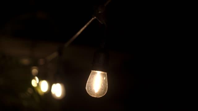 Warm lighting, vintage garland of lamps or glass lantern, electric bulbs