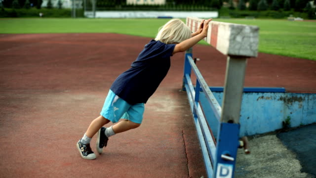 warm up little boy a young boy warming up young singles stock videos & royalty-free footage