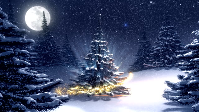 Warm winter landscape with golden decorated Christmas tree.