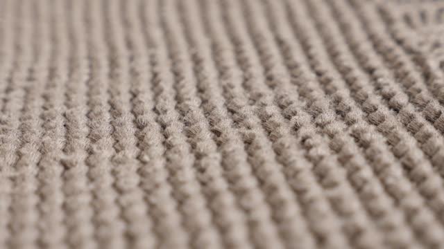 Warm women sweater knitwork slow tilt 4K 2160p 30fps UltraHD footage - Brown thick wool ribbing or stockinette knitting details 3840X2160 UHD tilting video video