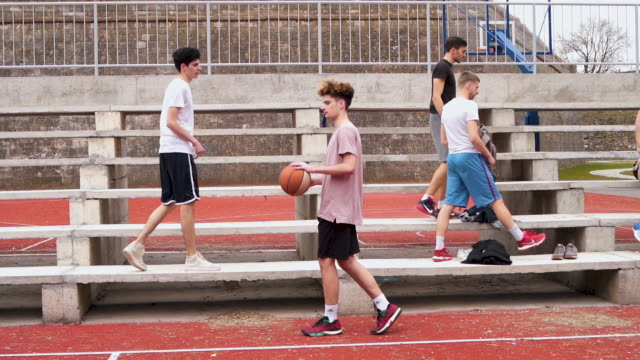 Warming up before basketball game Group of young adults playing amateur basketball outdoor practice drill stock videos & royalty-free footage