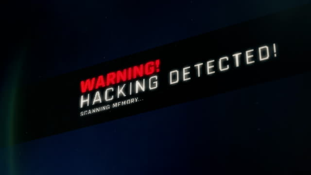Warning message on screen, hacking detected, threat found, system breach