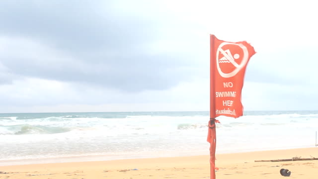 warning red flag tropical beach