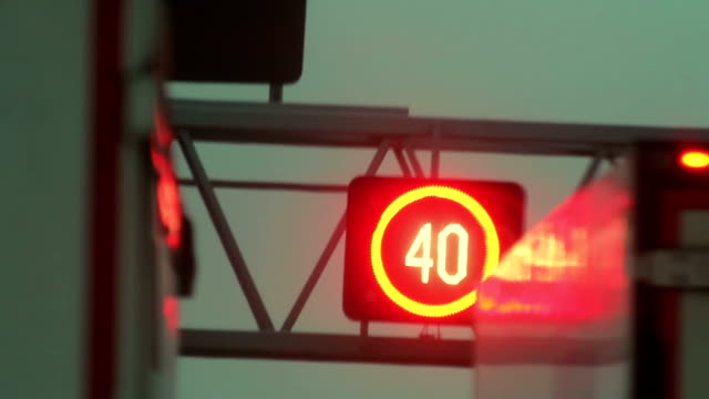 stockvideo's en b-roll-footage met warning signs on a busy motorway - maximumsnelheid bord