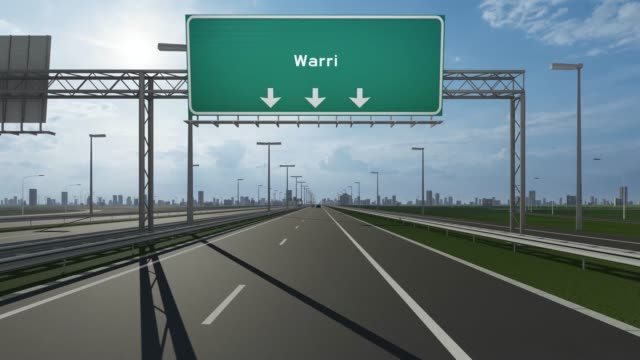 warri city signboard on the highway conceptual stock video indicating the entrance to city - nigeria video stock e b–roll