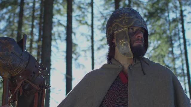 Warrior holding the Dacian Draco