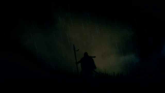 A Warrior Standing Alone in a Field Under Storm