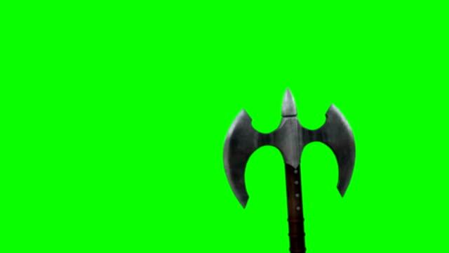 vídeos de stock e filmes b-roll de a warrior waving his deadly axe on a green screen background - escudo