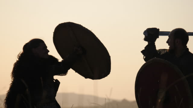 Warriors fighting at dusk