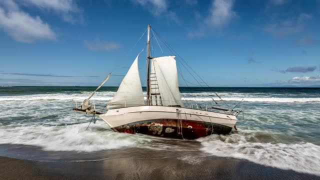Washed Ashore Sailboat on Beach