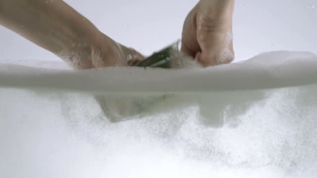 Washing A Glass In Slow Motion video