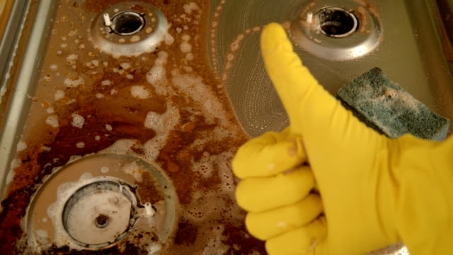 washing a household stove by a man. - fornello video stock e b–roll
