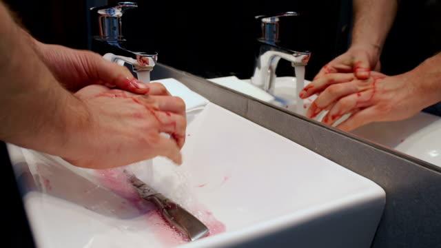 washing blood from knife and hand - rana filmów i materiałów b-roll