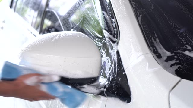 Washing car, cleaning car.