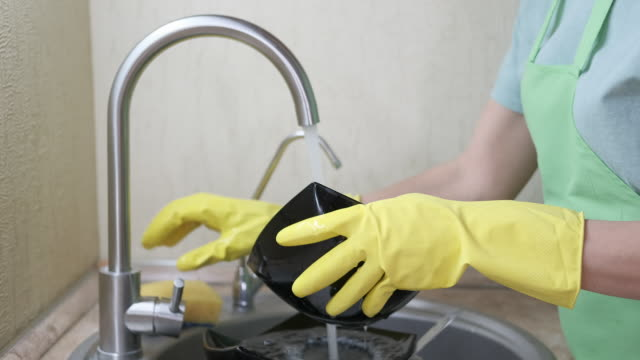 washing dishes by hand. - eastern european descent stock videos & royalty-free footage