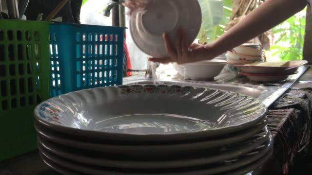Washing dishes Washing dishes dishwashing liquid stock videos & royalty-free footage