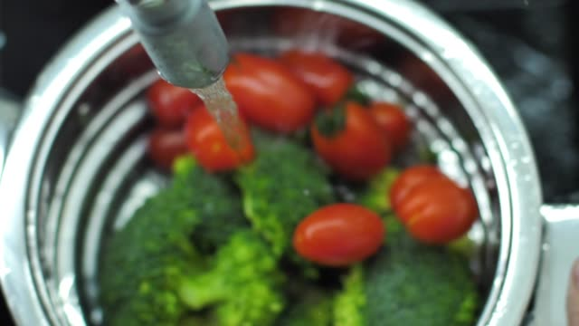 Washing fresh vegetables slow motion video video