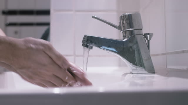 Washing Hands in a Bathroom Sink video