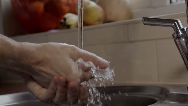 Washing Hands In A Domestic Kitchen video