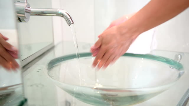 Washing hands in luxury bathroom video