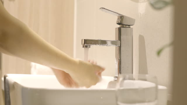 washing hands in washroom - igiene video stock e b–roll