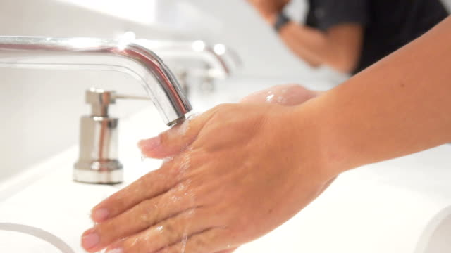 Washing hands under running water,Slow motion Washing hands under running water,Slow motion handle stock videos & royalty-free footage