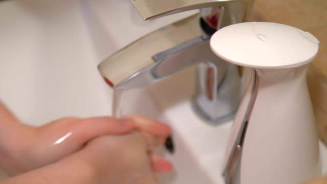 Washing hands with a soap in 4k slow motion 60fps video