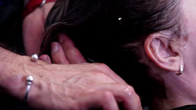 Washing head. Male hand wash head stylist client the salon video