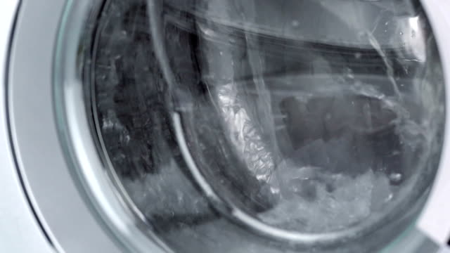 washing machine door with rotating in slow motion - disinfectant stock videos & royalty-free footage