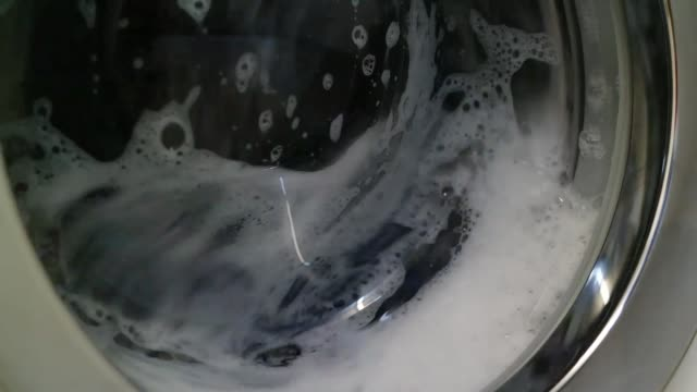 washing machine going through the wash cycle no people close up - bleach stock videos & royalty-free footage