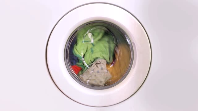 Washing machine turning - front view video