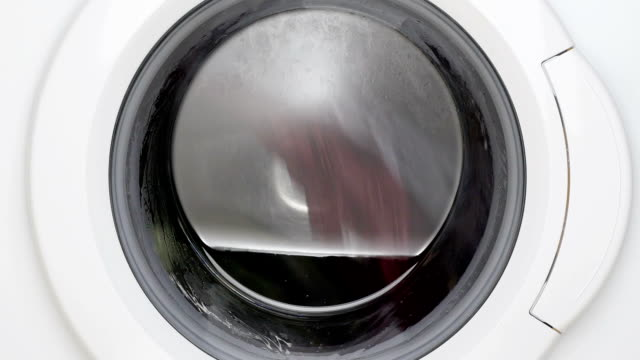 washing machine turning. - veicolo a due ruote video stock e b–roll