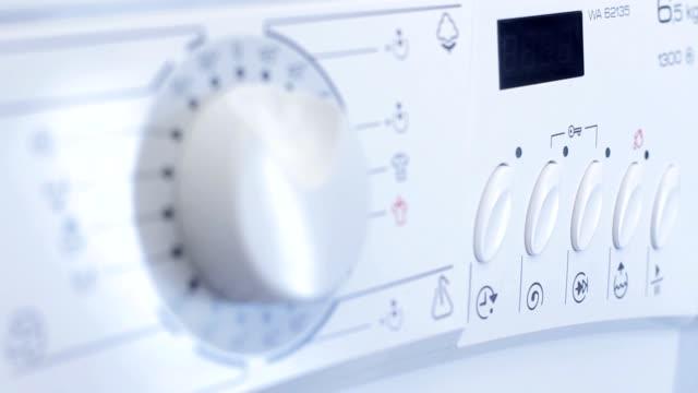 Washing Machine programming and turn the washing machine dial stock videos & royalty-free footage