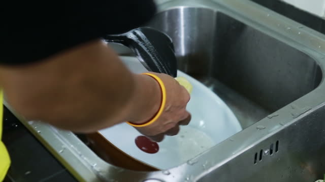 Washing pan at steel sink Washing pan at steel sink dishwasher stock videos & royalty-free footage