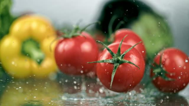 SLO MO Washing tomatoes