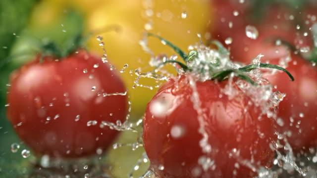 SLO MO CU Washing tomatoes