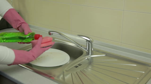 Washing Woman washing dishes dishwashing liquid stock videos & royalty-free footage