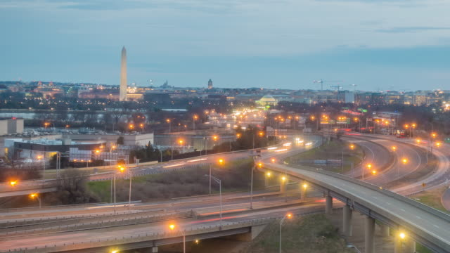 Washington, D.C. city skyline at twilight Night to Day time lapse of Washington, D.C. city skyline traffic time lapse stock videos & royalty-free footage