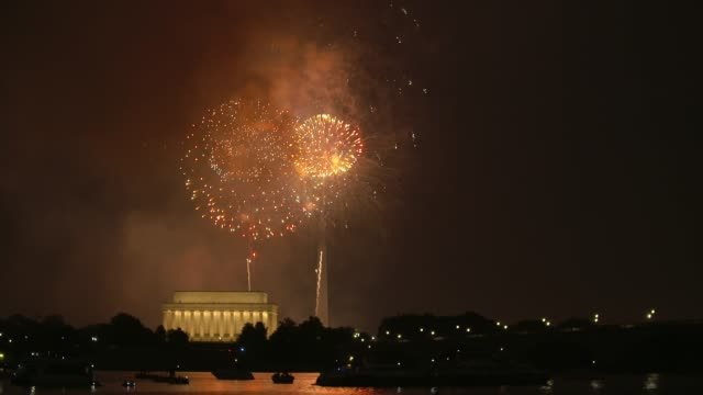 Washington DC Fireworks with the Lincoln Memorial and Kayakers in the foreground Beautiful Fireworks shot in Washington DC on the 4th of July with the Lincoln Memorial and Washington Monument in view with reflections and boaters in the Potomac River july 4th stock videos & royalty-free footage