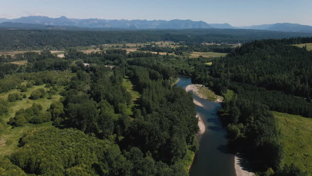 Washington Evergreen State Rural Aerial Background with Forest River and Mountains