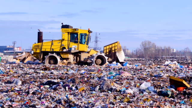 Waste, garbage, dump, rubbish 4K. A landfill compactor working at a lanfill site. video