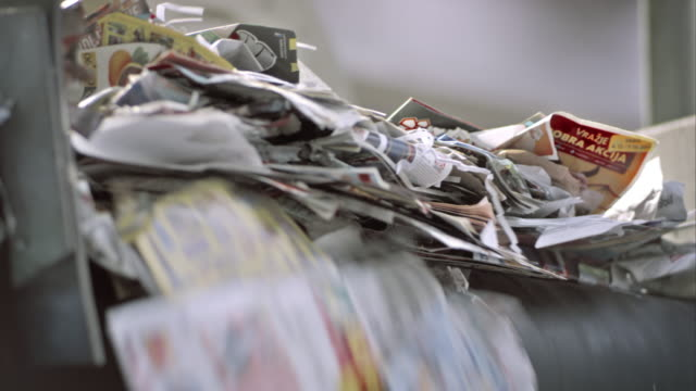 ld waste paper falling off the conveyor belt - recycling stock videos & royalty-free footage