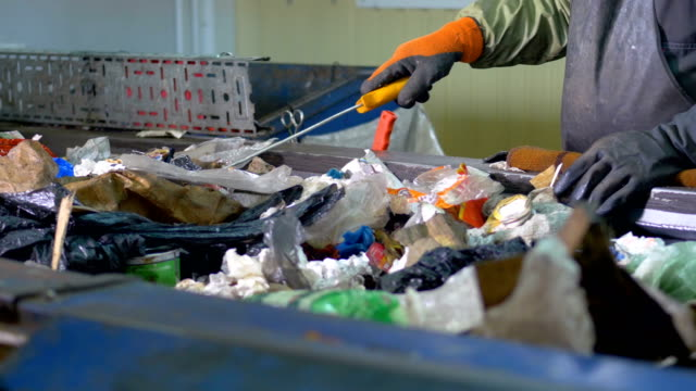 vídeos de stock e filmes b-roll de waste recycling plant. workers sorting garbage for recycling. - box separate life