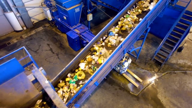 Waste Seperating conveyor. Recycling plant indoors. video