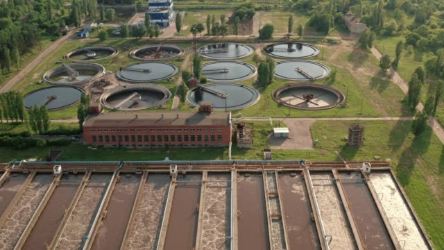 Wastewater treatment plant, round pools for filtration of dirty or sewage water, aerial view video