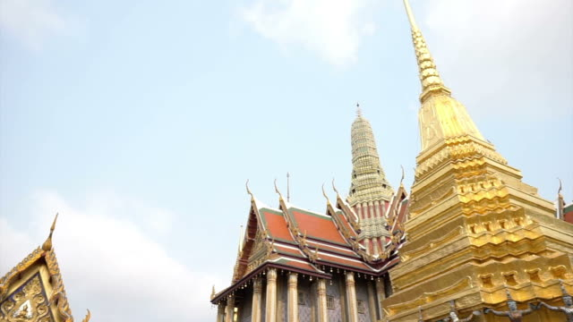 Wat Phra Kaew, Grand palace, Temple of the Emerald Buddha with sky and green lawn. Landmark of Bangkok,Thailand video