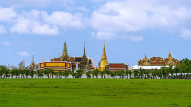 Wat Phra Kaew or the Temple of the Emerald Buddha in Grand Palace, and Sanam Luang field, Bangkok, Thailand - Time-lapse