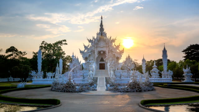 wat rong khun beautiful white temple landmark travel place of chiang rai, thailand 4k hyper time lapse sunrise - tempio video stock e b–roll