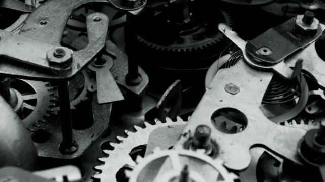 Watch mechanism macro loop. Old vintage clock mechanism working, closeup shot with soft focus. Close up of a internal clock mechanism. Vintage Watch Gears Movement Macro.